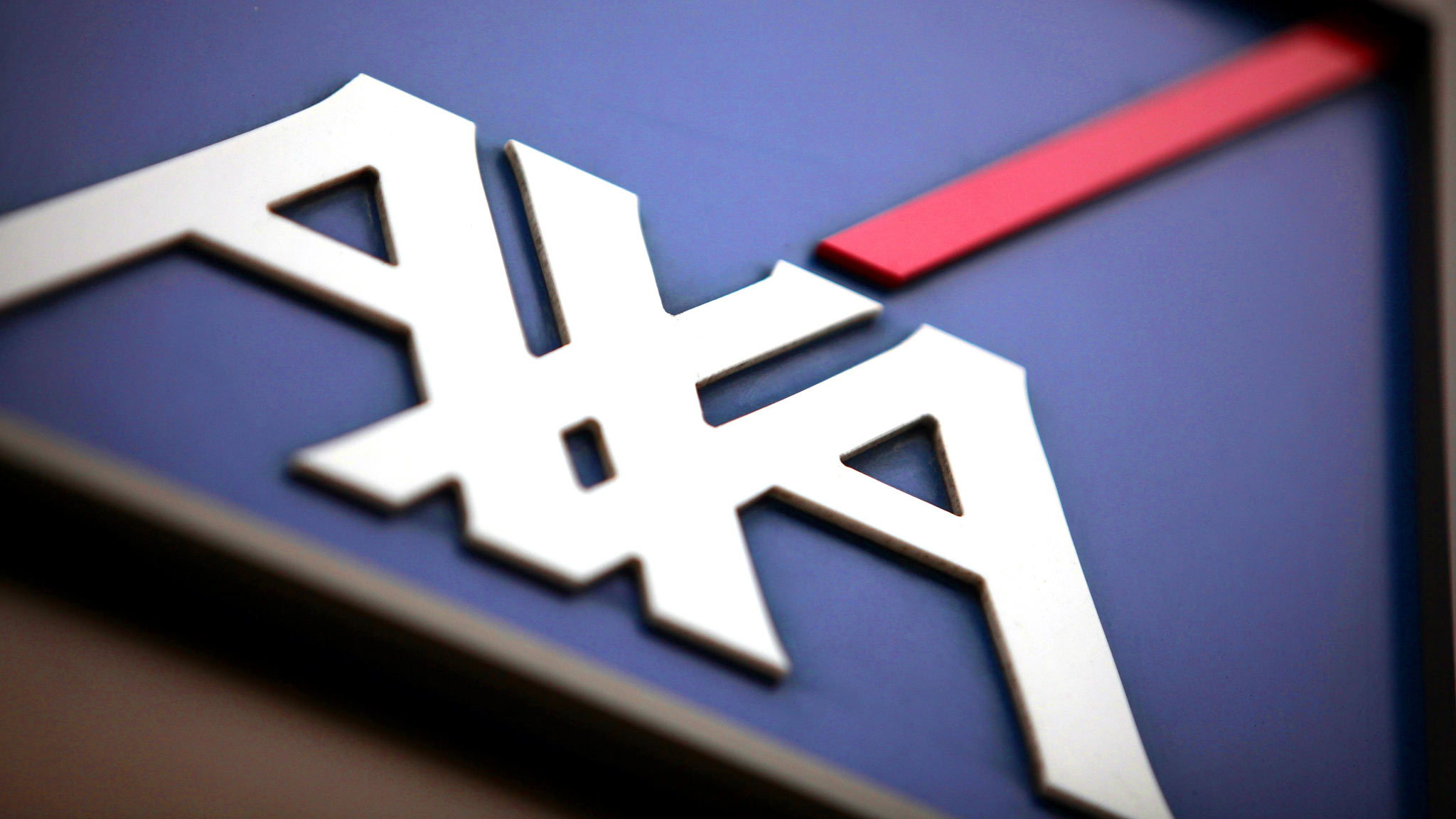 AXA RESOLUTION SALE...The Axa SA company logo sits outside the offices of Axa U.K., in London, U.K., on Monday, June 14, 2010. Axa SA, Europe's second-biggest insurer, said it's in talks to sell part of its U.K. life insurance unit to Clive Cowdery's Resolution Ltd. for 2.75 billion pounds ($4 billion). Photographer: Jason Alden/Bloomberg